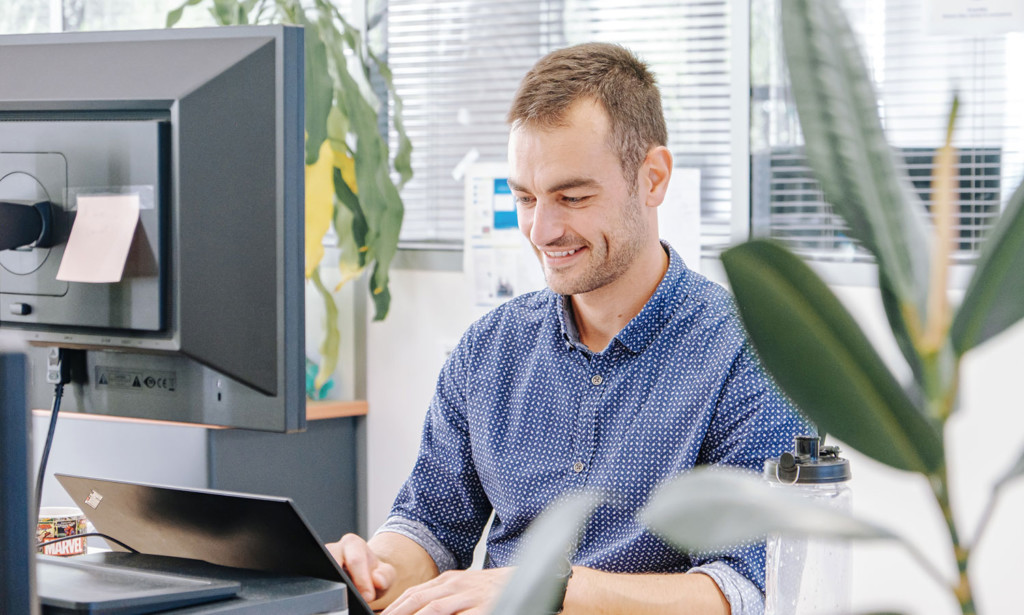 About us man at laptop