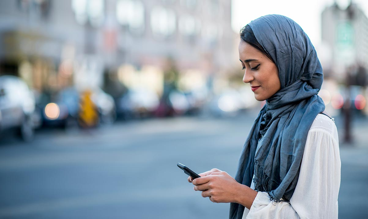 Lady using smartphone in street